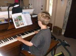 Isaac playing the piano
