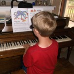 Isaac practicing for his next piano lesson