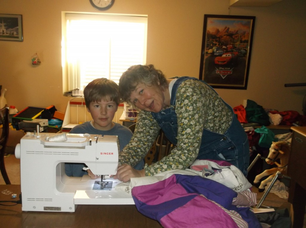 Caleb, 13, at the sewing machine.