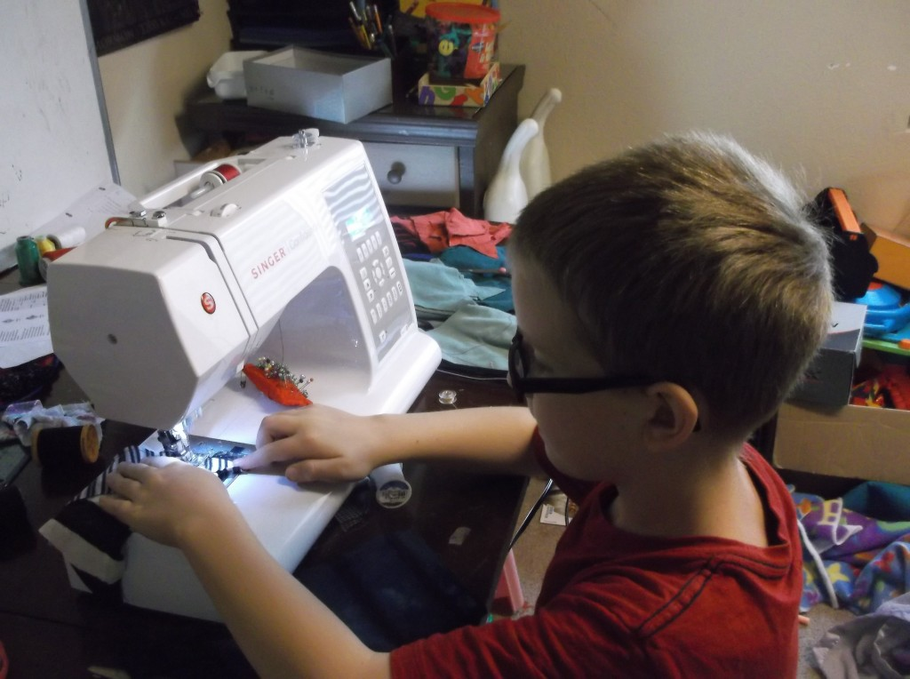 Isaac, 8, at the sewing machine.