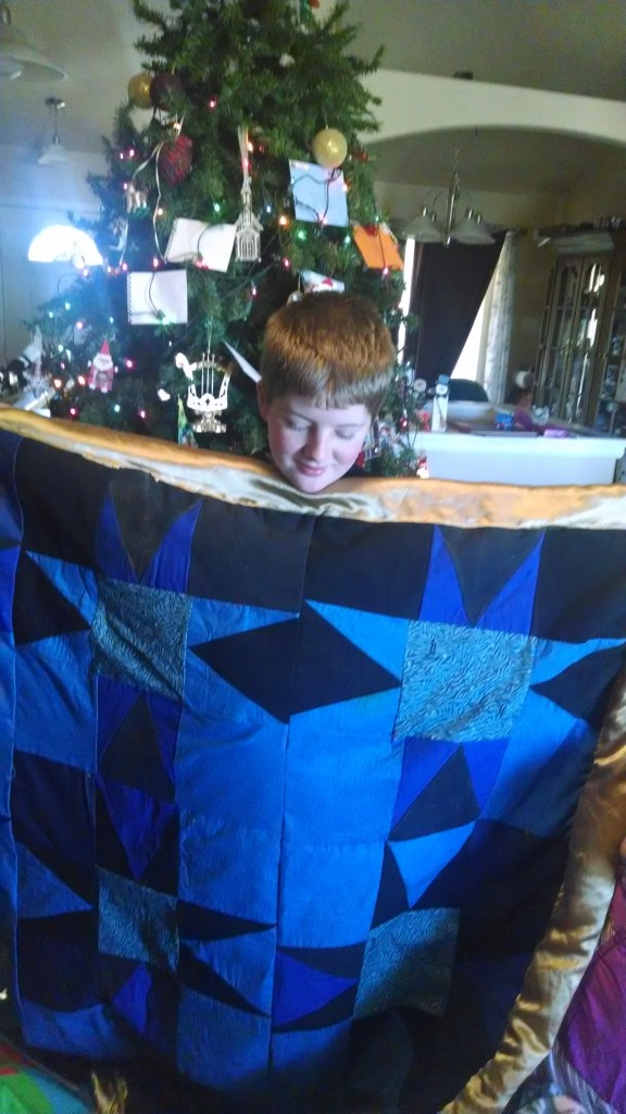 Caleb with his quilt.