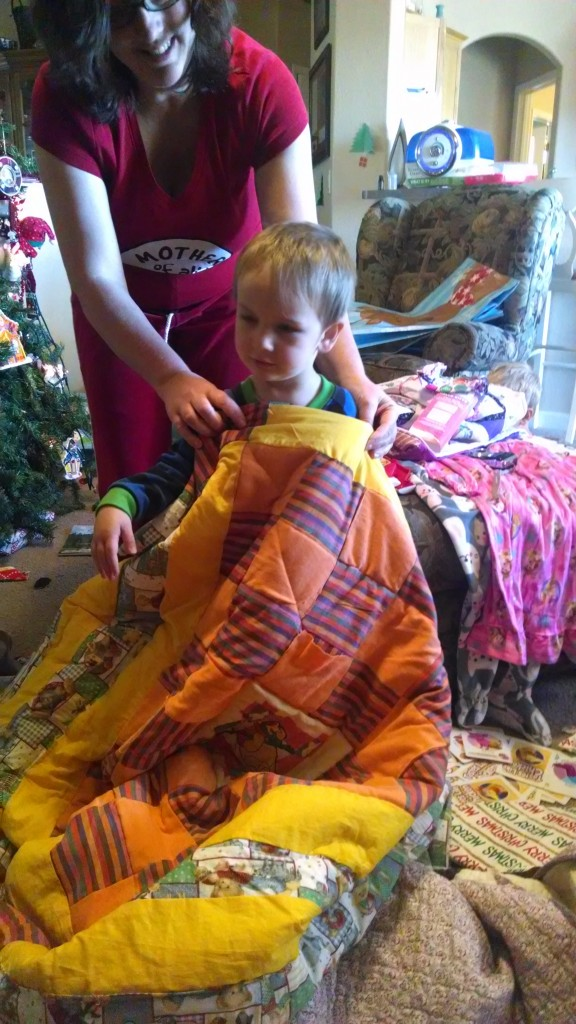 Jesse, 2, with his quilt.
